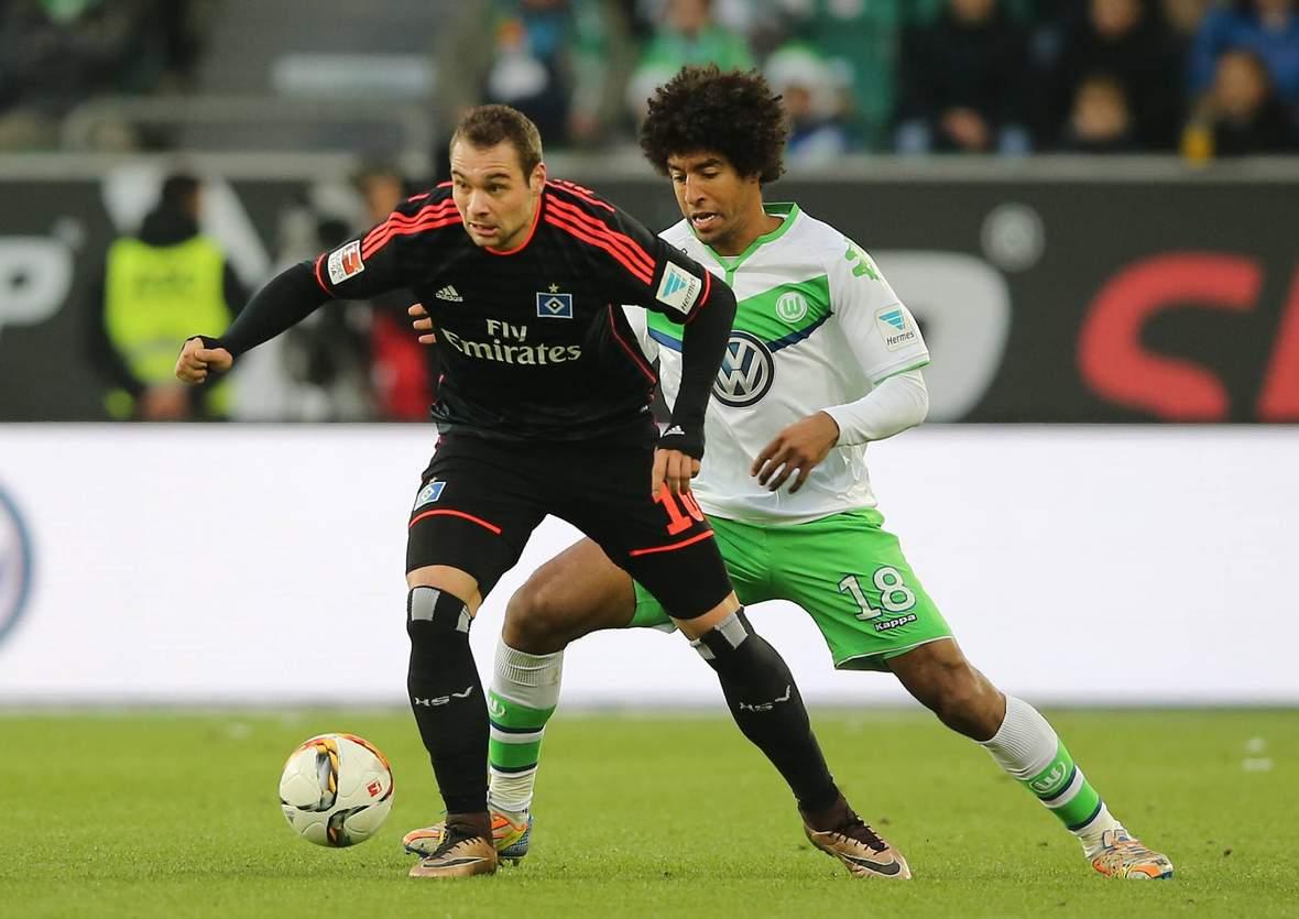 Pierre-Michel Lasogga behauptet sich gegen Dante. Unser Tipp: Der HSV gewinnt nicht gegen Wolfsburg.